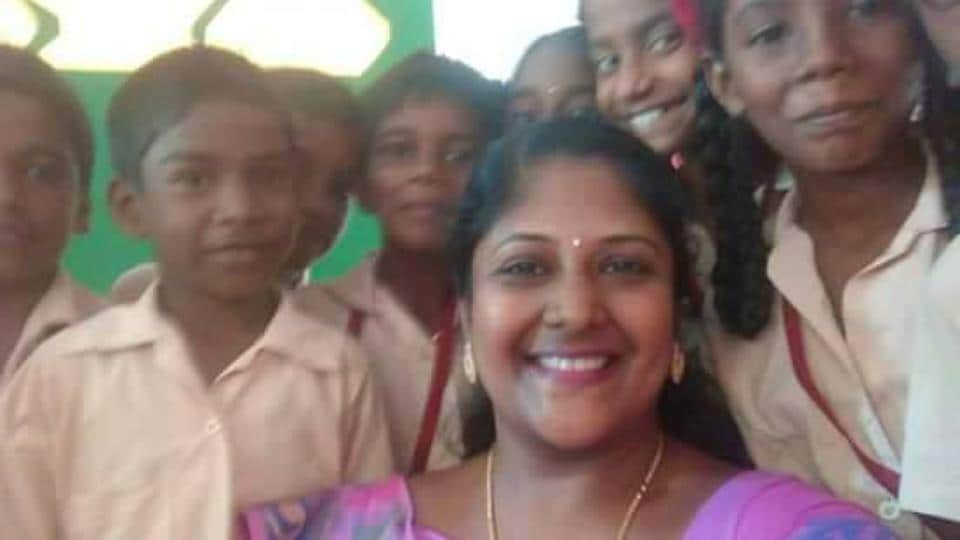 A smiling Annapurna Mohan takes a selfie with her students at Kandhadu in Villupuram, Tamil Nadu.