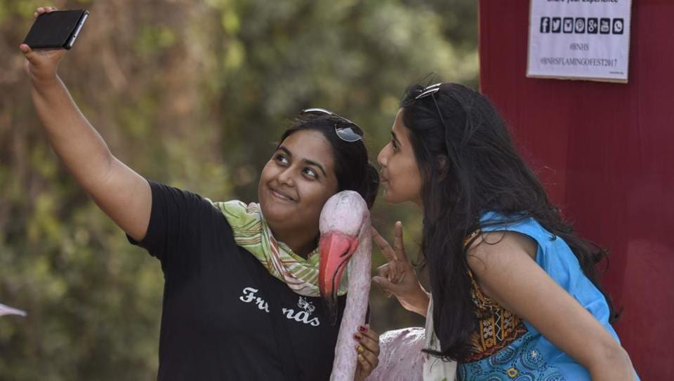 People throng to take a look of flamingos during the annual event  at Sewri on Saturday. (Kunal Patil/HT Photo)
