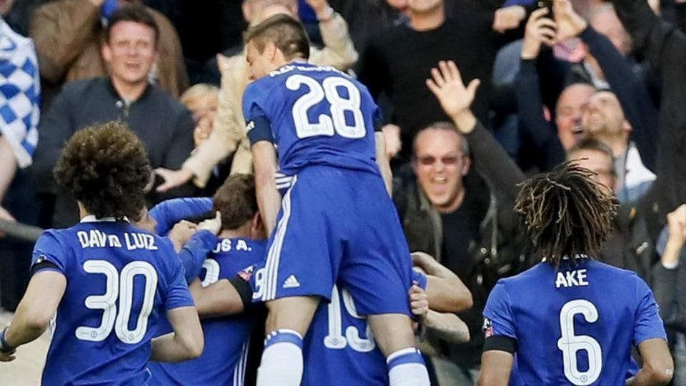 Chelsea Football Club's Nemanja Matic celebrates with teammates after scoring his side's fourth goal during the English FA Cup semifinal match against Tottenham Hotspur F.C. at Wembley stadium in London on Saturday.