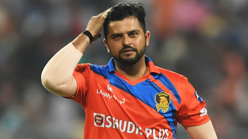 Gujarat Lions captain Suresh Raina (L) reacts as Kolkata Knight Riders cricketer Sunil Narine walks back to the pavilion after his dismissal during their 2017 Indian Premier League (IPL) T20 match at the Eden Gardens in Kolkata on Friday.