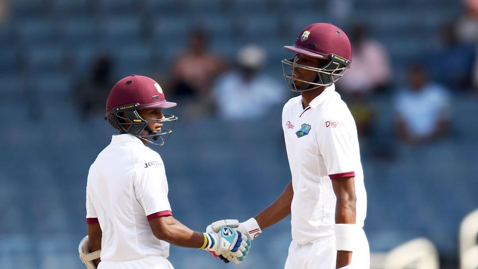 West Indies batsman Roston Chase (R) is congratulated by his teammate Shane Dowrich after scoring his half century on day one of the first Test match against Pakistan at the Sabina Park in Kingston, Jamaica, on Friday.