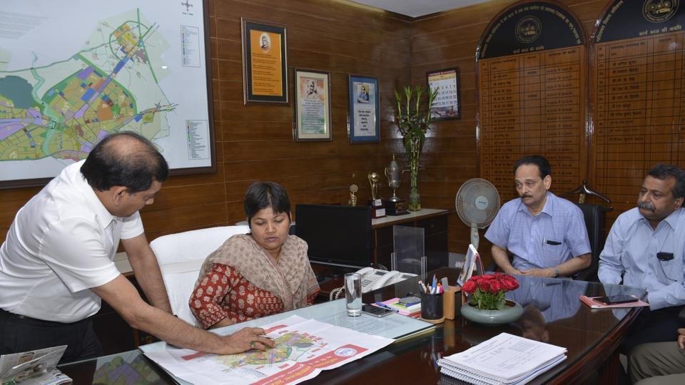 Kanchan Verma talks to officials at the Ghaziabad Development Authority on Saturday.