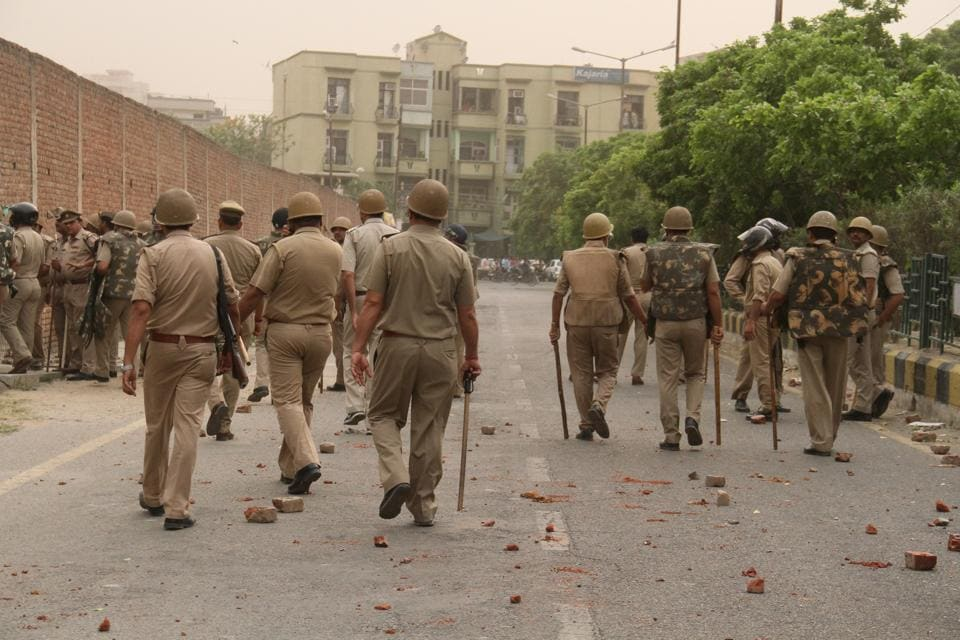 The residents threw bricks and stones at the police.