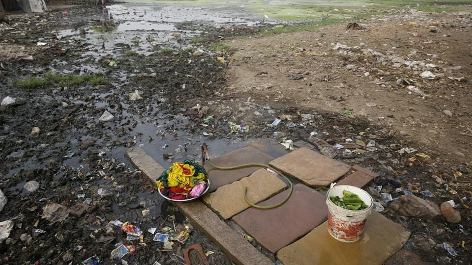 Clothes washing pile sits in a polluted field as world observes international Earth Day in Allahabad. (Rajesh Kumar Singh/AP)