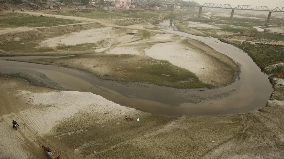 The dried up Ganga river basin at Sangam, winds through the confluence of the Ganges, Yamuna, and the mythical Saraswati River on the world Earth Day in Allahabad. (Rajesh Kumar Singh/AP)