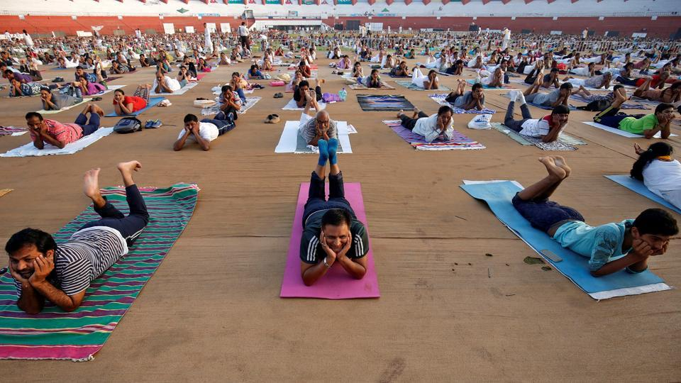Participants perform yoga at a camp in Ahmedabad.