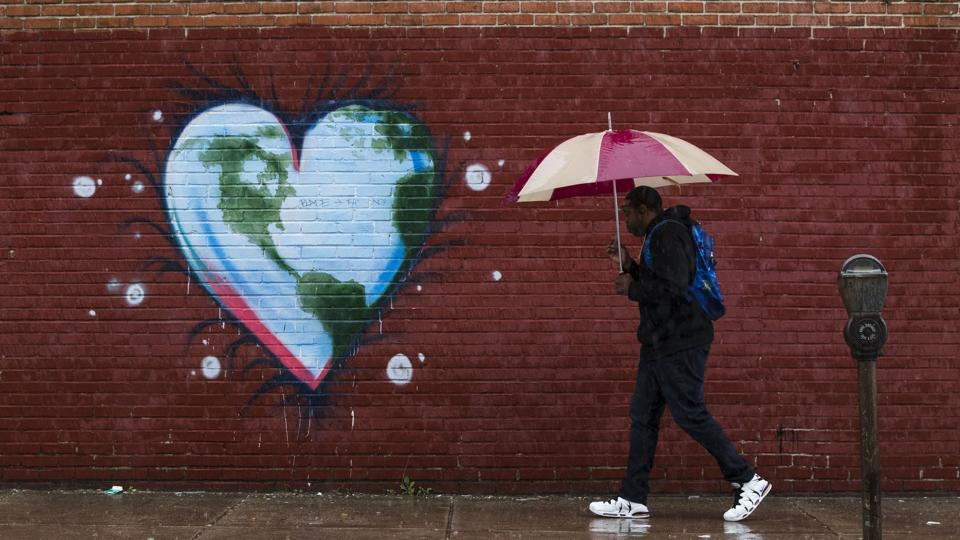 A man walks past a mural the day before Earth Day, in Philadelphia. (Matt Rourke/AP)