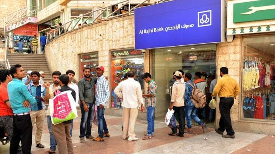 Indian workers queue outside a bank branch in the Saudi Arabian port city of Jeddah. Saudi Arabia, one of the most sought destinations for Indians taking up blue-collar jobs abroad, took in nearly 50% less workers last year than it did in 2015.