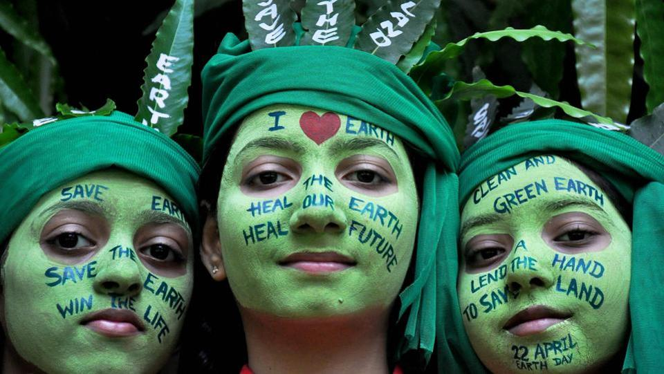 School girls with painted faces pose for a picture during 'Save Earth' awareness program on the eve of World Earth Day at a school in Moradabad, Uttar Pradesh. (PTI)