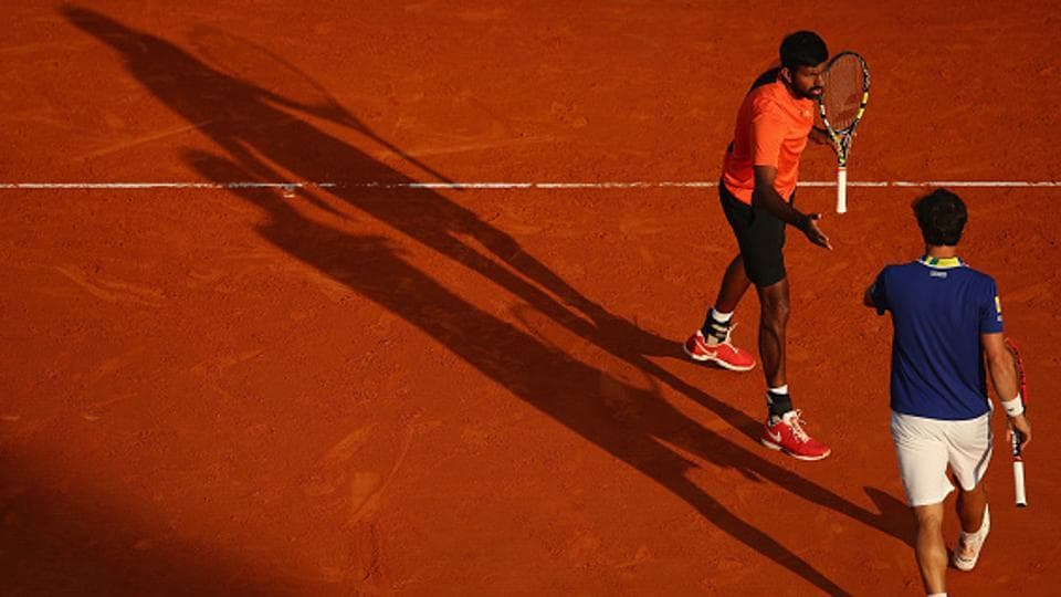 Rohan Bopanna of India and Pablo Cuevas of Uruguay celebrate a point against Romain Arneodo of Monaco and Hugo Nys of France in their semifinal doubles match of the Monte Carlo Masters at Monte-Carlo Sporting Club on Saturday.