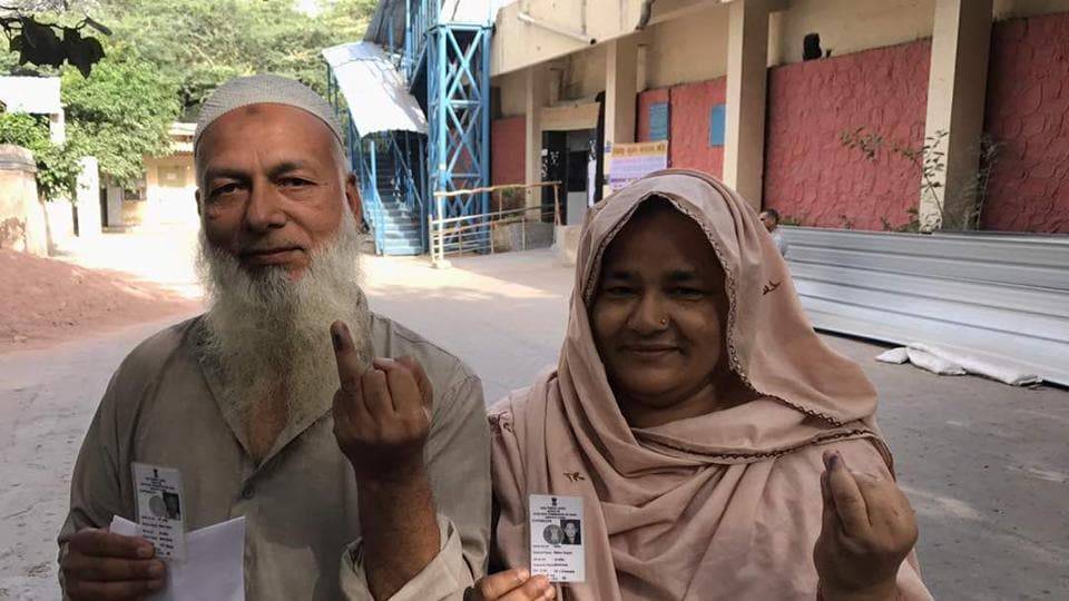 A Muslim couple shows their inked fingers after casting vote in Delhi MCD elections at Rajpura road polling station. People turning up to vote say issues, such as drinking water facilities, waste disposal, pollution, have been their main concerns and they hope for effective municipalities that can assure better basic amenities. (Ravi Choudhary/HT Photo)