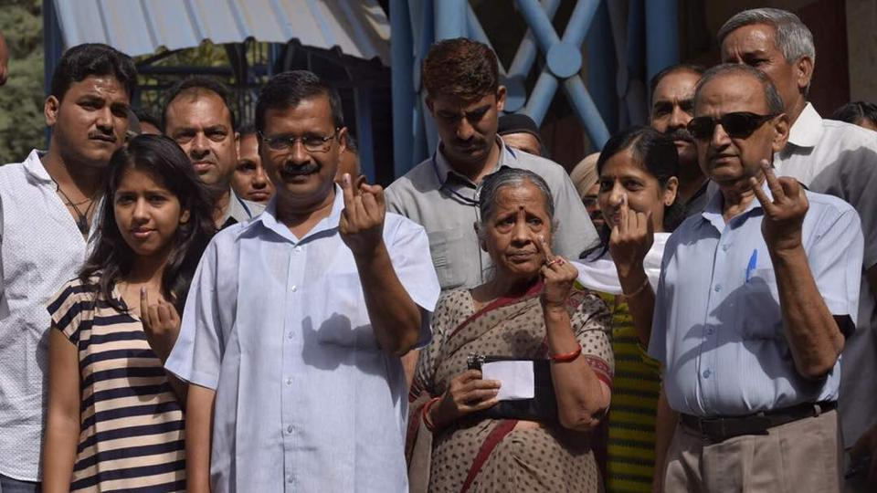 Delhi CM Arvind Kejriwal with his family after casting their vote. Among other leaders who have cast their vote are deputy chief minister Manish Sisodia, Congress leaders Ajay Maken and BJP leader Dr Harshvardhan. (Ravi Choudhary/HT Photo)
