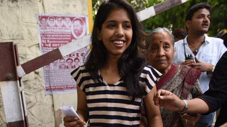 Delhi CM Arvind Kejriwal's daughter Harsita after casting her first vote at Rajpura road polling station. Elaborate security arrangements are made across the Capital for the election.  (Ravi Choudhary/HT Photo)