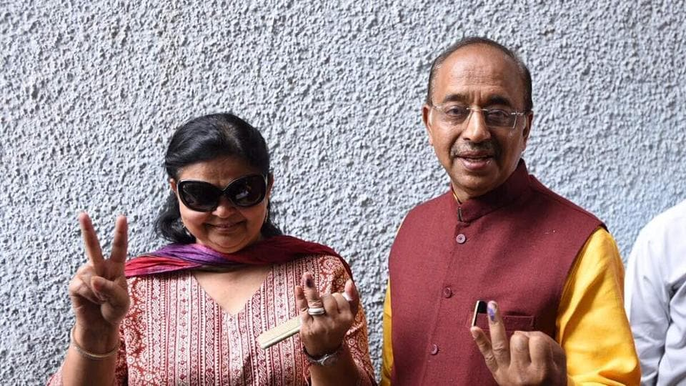 Sports minister Vijay Goel with his Wife pose for a picture after casting their vote at St. Xaviers School near Rajniwas. In all, 18 parties are in the fray this time. Over 2,537 candidates are contesting the polls with as many as 1,174 of them fighting as independents. (Ravi Choudhary/HT Photo)