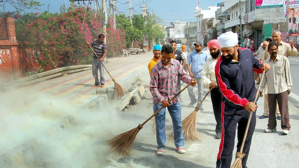 Residents and municipal corporation employees participating in a cleanliness campaign in Amritsar on Saturday.