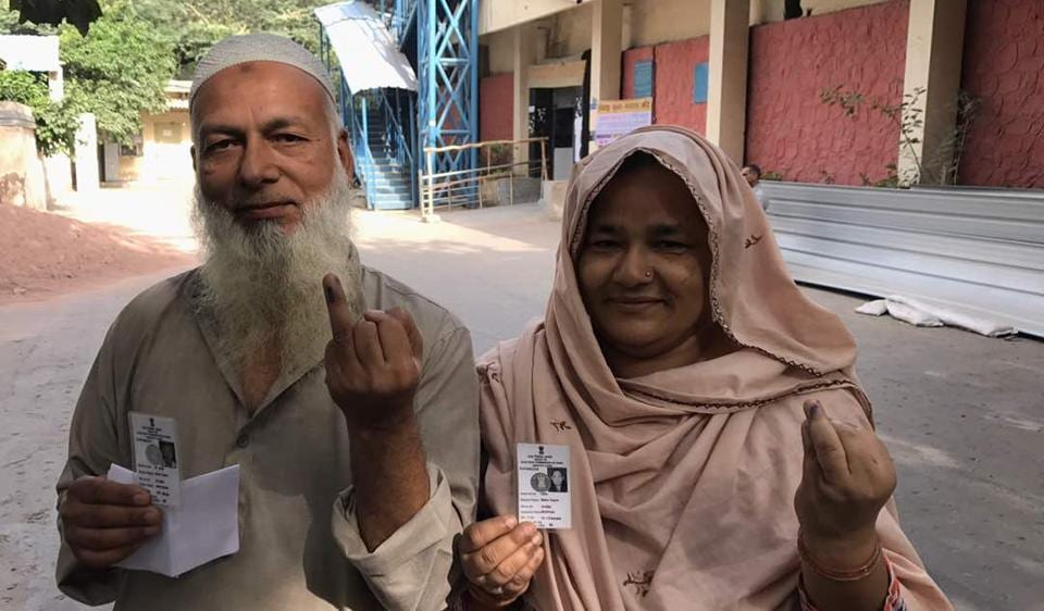 A couple after casting their vote in MCD election at Rajpura Road polling booth in north Delhi.
