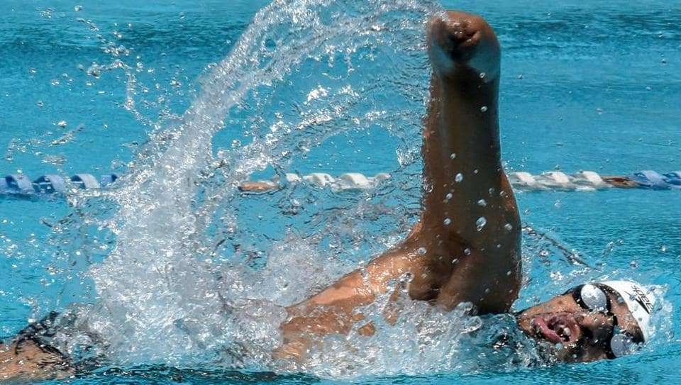 TRIUMPH OFTHEWILL: Paralympian Suyash Jadhav participates in 11th state-level swimming competition for differently abled swimmers at Andheri in Mumbai. (Kunal Patil/HT Photo)