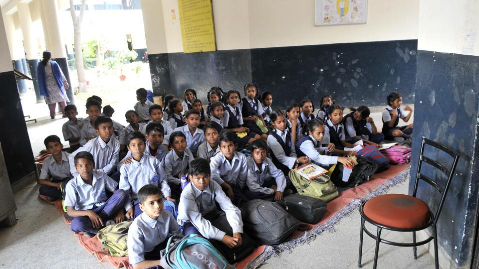Students of Class 6 sitting in a corridor at Kajheri government school in Chandigarh.