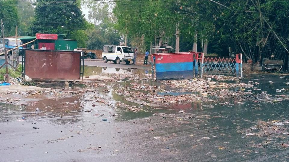 Rains choked drains and flushed filth on roads in Dehradun.