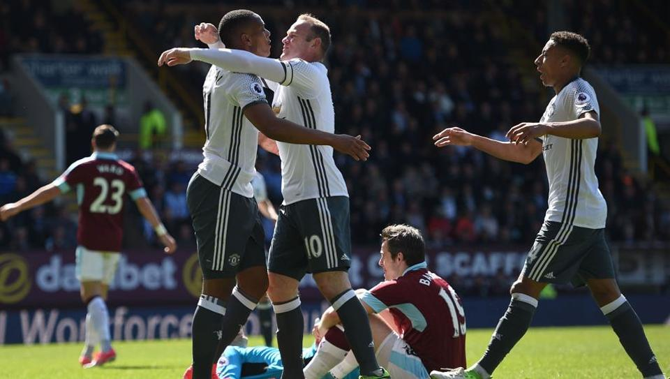 Manchester United F.C. strikers Anthony Martial (left) and Wayne Rooney celebrate their side's opening goal (by Martial) against Burnley F.C. at Turf Moor in Burnley onSunday.