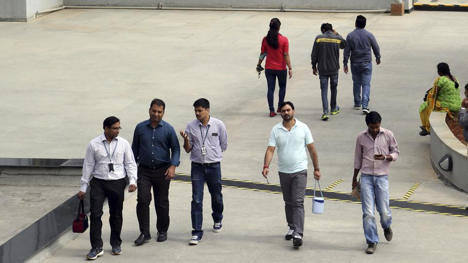 Wipro employees walk inside the company's compound during a break at their headquarters in Bangalore. The Indian middle class, riding the  youthful economic energies unleashed by digital technologies, needs a fresh and hopeful script for its growth story.