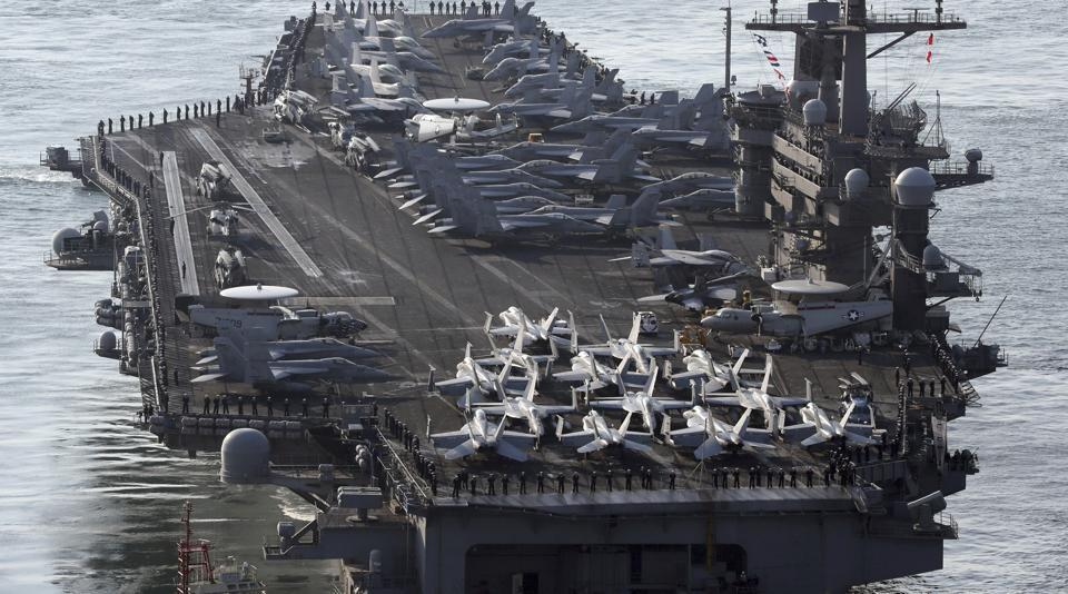 USNavy aircraft carrier, the USS Carl Vinson, approaches Busan port in Busan, South Korea, to participate in an annual joint military exercise called Foal Eagle between South Korea and the United States.