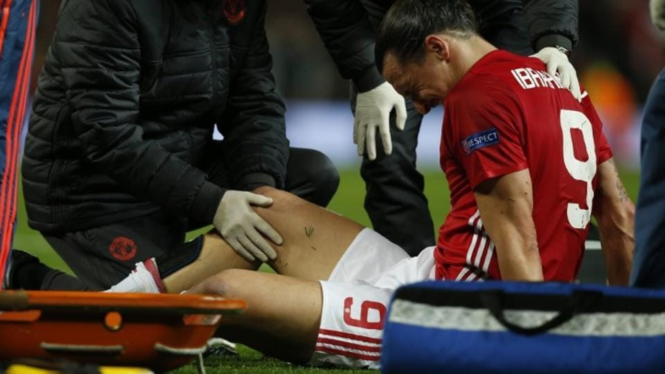 Manchester United's Zlatan Ibrahimovic receives medical attention after sustaining the knee injury during the Europa League match against Amderlecht on Thursday.
