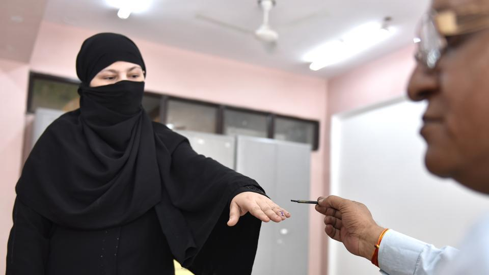 A Muslim lady casting her vote at polling booth near Jama Masjid on Sunday.