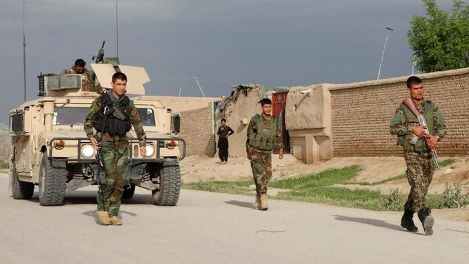 Afghan national Army (ANA) troops arrive near the site of an ongoing attack on an army headquarters in Mazar-i-Sharif, northern Afghanistan.