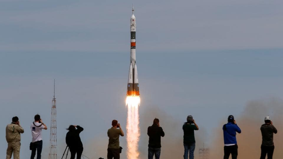 Photographers take pictures as the Soyuz MS-04 spacecraft carrying the crew of Jack Fischer of the U.S. and Fyodor Yurchikhin of Russia, as it blasts off to the International Space Station (ISS) from the launchpad at the Baikonur Cosmodrome, Kazakhstan on April 20, 2017.  (Shamil Zhumatov/REUTERS)