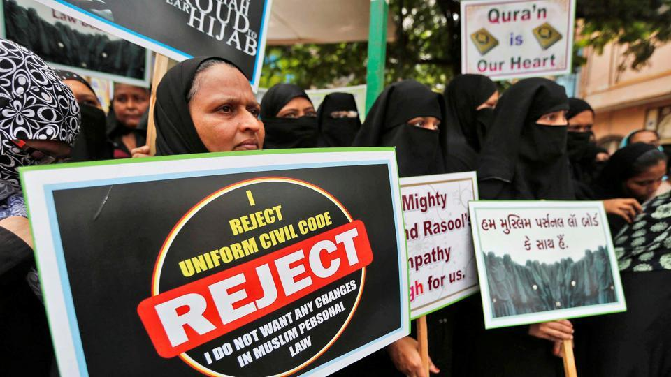 Muslim women hold placards in support of the All India Muslim Personal Law Board during a signature campaign in Ahmedabad.