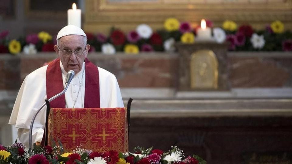Pope Francis leads a mass at the Basilica of Saint Bartholomew on Tiber island in Rome.