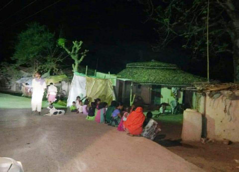 Villagers gathered outside the victim's house after a neighbour forcefully inserted a beer bottle into the private parts of a woman in Latehar, resulting in her death three days later on Saturday.
