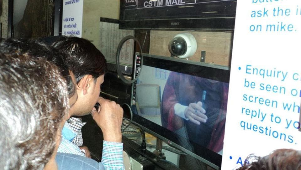 A passenger seeks information about trains using a video-based enquiry system at Jabalpur railway station.