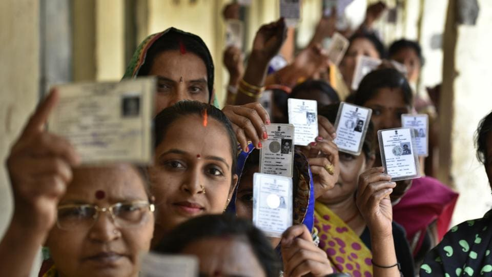 Voters queue up to vote in the municipal corporation election on Sunday.