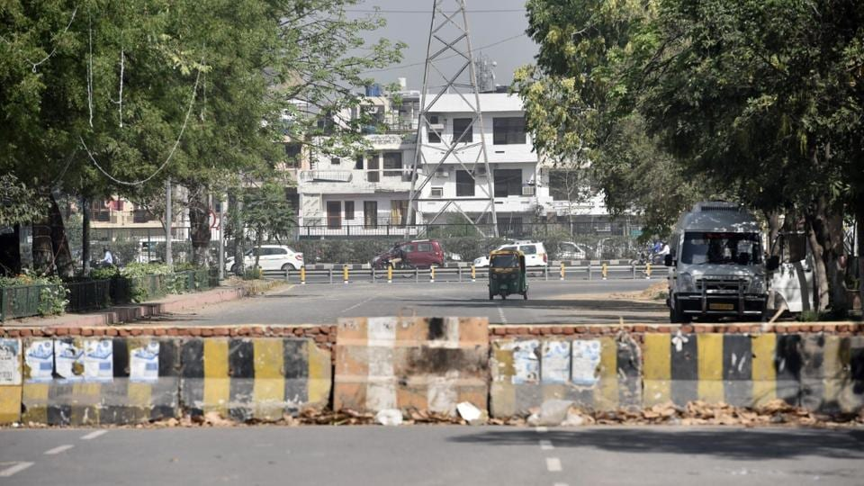 The makeshift wall that was erected on April 11, blocking the main access road connecting Sector 29 market and a service lane of NH-8.