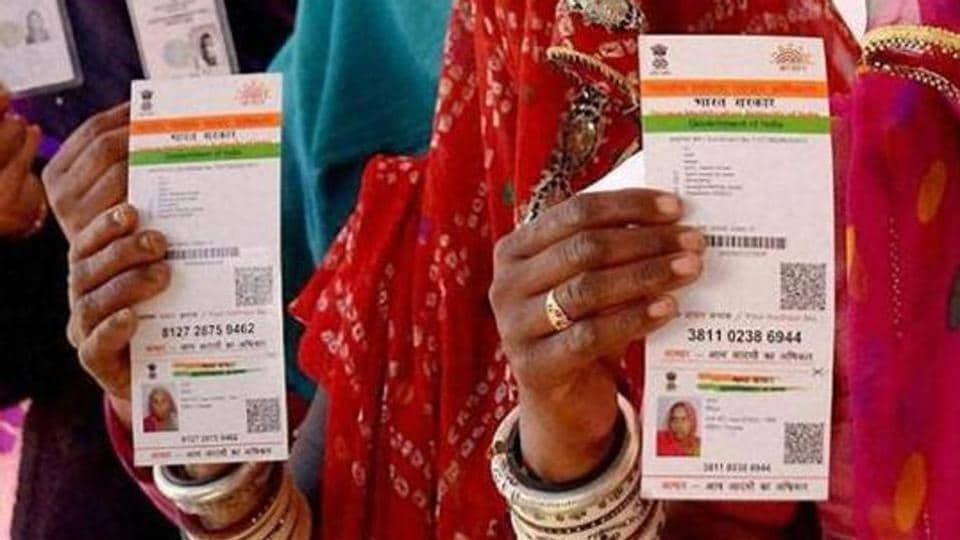 Women in Rasjasthan showing their respective Aadhaar cards.