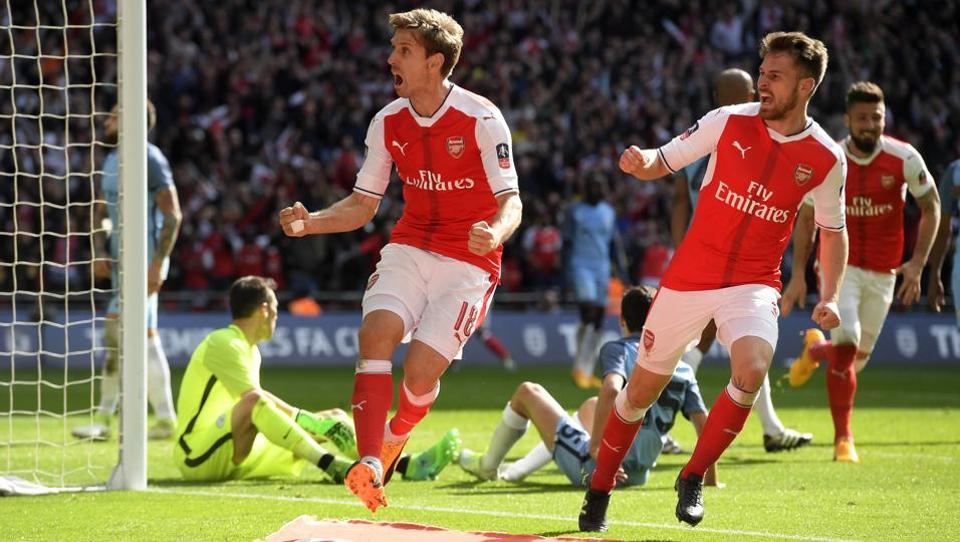 Arsenal's Nacho Monreal (L) celebrates scoring their first goal with teammate Aaron Ramsey during the FA Cup semi-final clash against Manchester City at Wembley in London on Sunday.