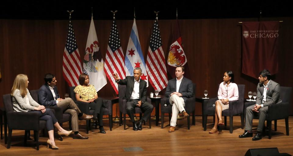 Former US president Barack Obama (centre) at a discussion at the University of Chicago on Monday.  Harish Patel, a student of Indian descent, is seated at the extreme right.