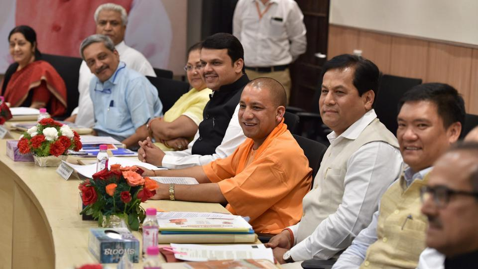 Sarbananda Sonowal, Yogi Adityanath, Manohar Parrikar and others at BJP chief ministers' council at party office in New Delhi.