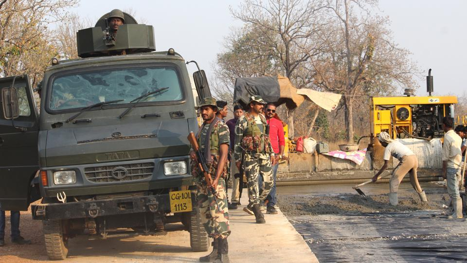 CRPF jawans at the ambush site where suspected Maoists killed over two dozen paramilitary personnel in Chhattisgarh .