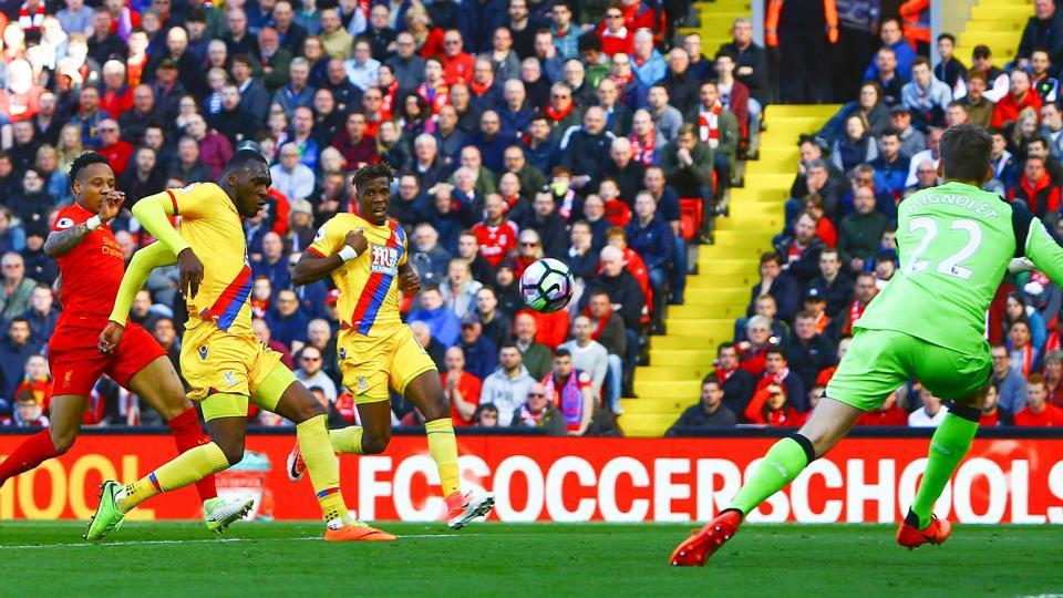 Crystal Palace's Zaire-born Belgian striker Christian Benteke shoots and scores past Liverpool's Belgian goalkeeper Simon Mignolet during their Premier League match at Anfield, Liverpool on Sunday.