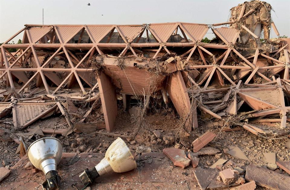 Built in 1972, the iconic Hall of Nations a permanent exhibition venue and a 20th-century heritage site at  Pragati Maidan was demolished on Sunday night. This was the country's first pillar-less building. (Shahbaz Khan  / PTI)