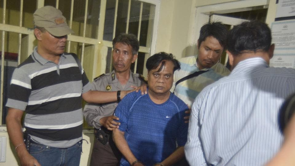 Police officials escort gangster Rajendra Nikalje (in blue), widely known as Chhota Rajan.