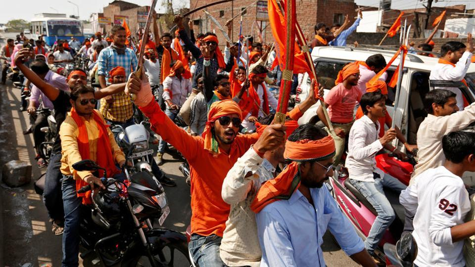 Hindu Yuva Vahini members take part in a rally in Unnao.