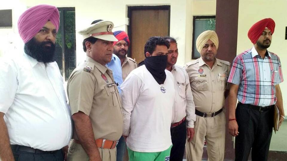 Rohit Kumar, accused of extortion and threatening a dhaba owner in police custody in Ludhiana on Sunday.