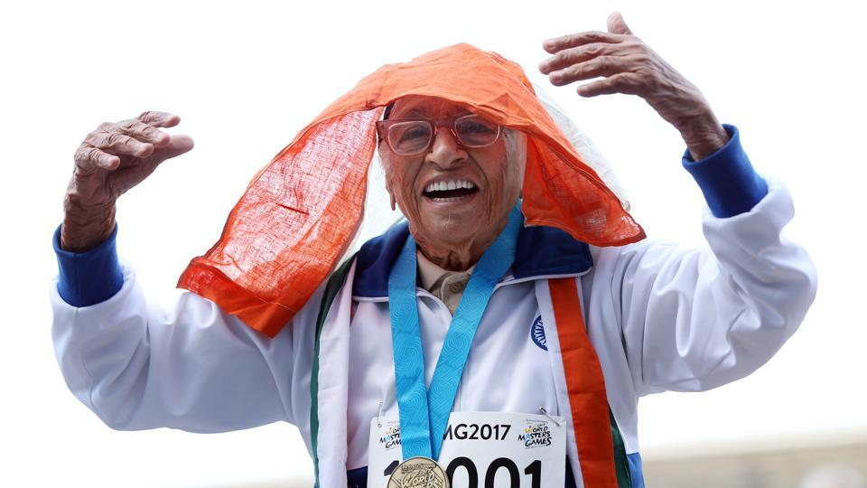 101-year-old Mann Kaur from India celebrates after competing in the 100m sprint in the 100+ age category at the World Masters Games at Trusts Arena in Auckland. Kaur clocked one minute 14 seconds as a small crowd cheered her on -- ending a mere 64.42 seconds off Usain Bolt's 100m world record set in 2009. (Michael Bradley/AFP)