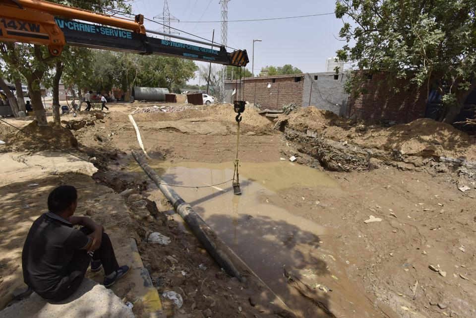 The leak in Huda water pipeline near Rajiv Chowk being repaired on Monday.