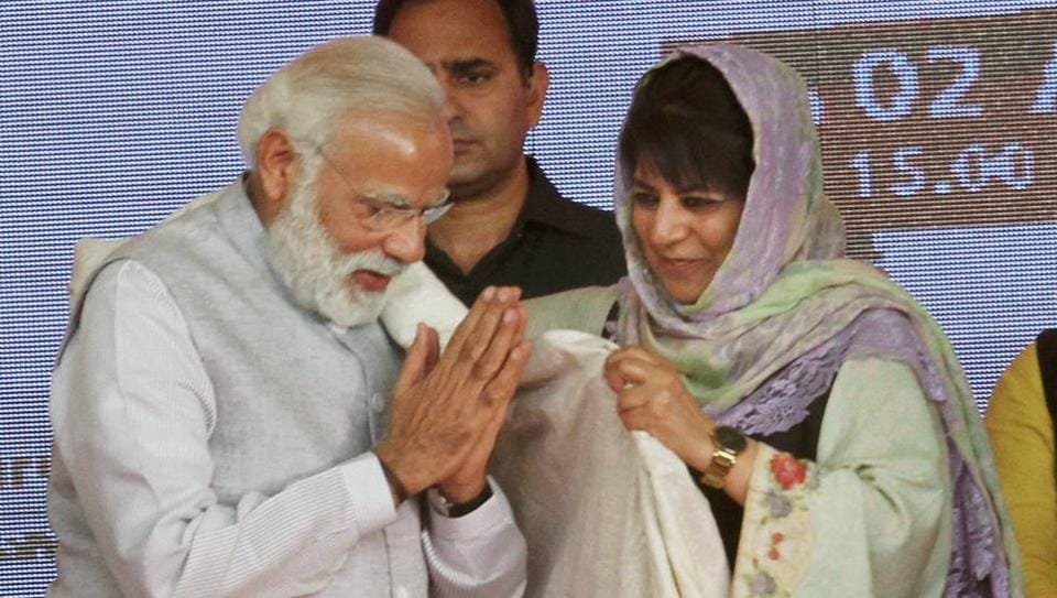 Prime Minister Narendra Modi being offered a shawl by Chief Minister of Jammu and Kashmir Mehbooba Mufti during a public rally at Battal in Udhampur, Jammu on April 2.