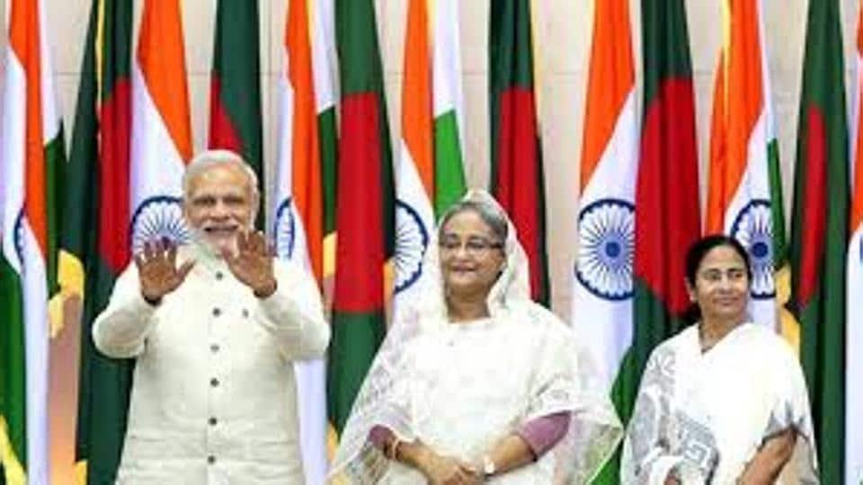 Sheikh Hasina, flanked by Narendra Modi and Mamata Banerjee in Delhi on April 8.